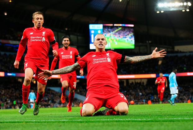 Martin Skrtel celebrates with teammates after scoring Liverpool's fourth goal against Manchester City