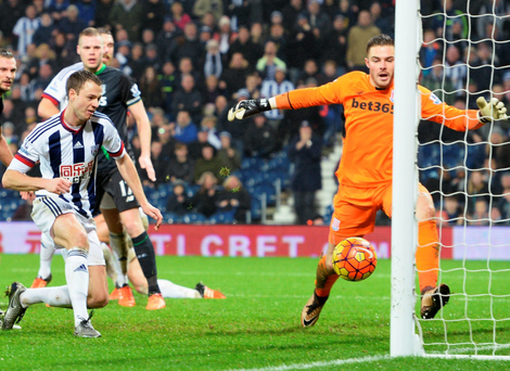 Jonny Evans squeezes the ball across the line for West Brom's late winner Photo: Getty