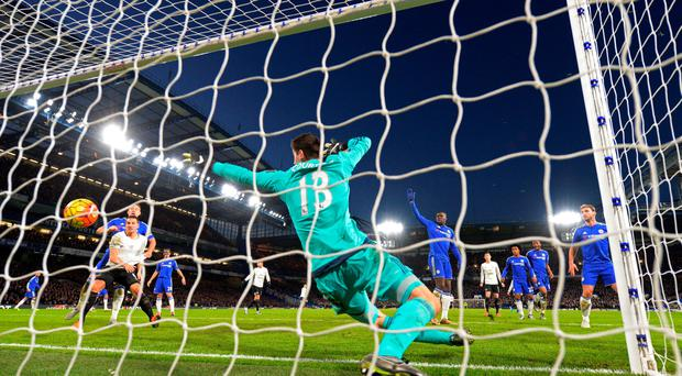 Thibaut Courtois of Chelsea fails to stop the shot by Ramiro Funes Mori