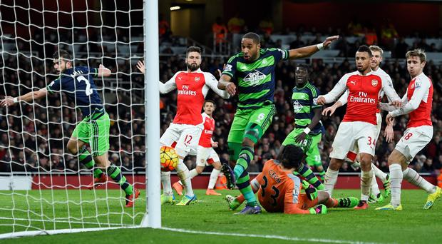 Ashley Williams bundles in a late winner for Swansea Photo: Reuters