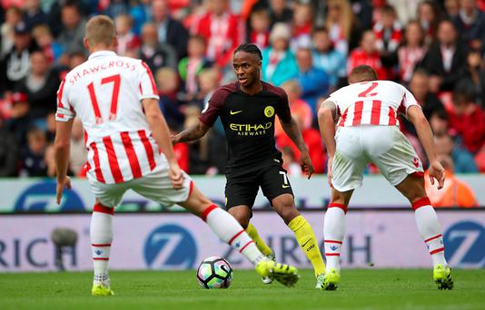 Raheem Sterling runs at Stoke defenders Ryan Shawcross and Phil Bardsley in Manchester City's victory Photo: Nick Potts