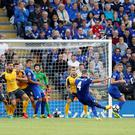 Leicester's Danny Drinkwater fires in a free-kick against Arsenal Photo: Reuters