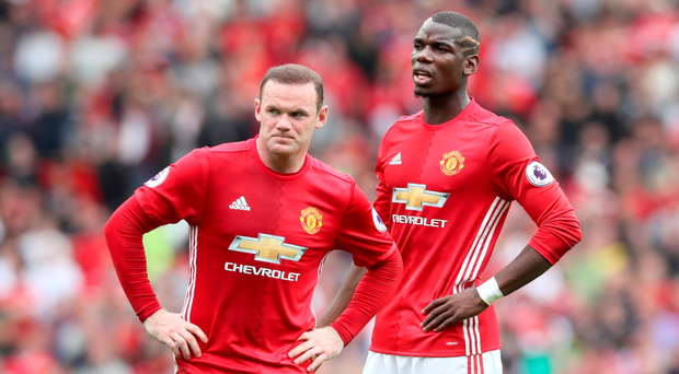 Manchester United's Wayne Rooney (left) and French star Paul Pogba. Photo: PA