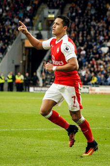Alexis Sanchez celebrates Arsenal's third goal. Photo: PA