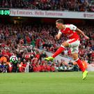 Mesut Ozil fires in Arsenal's third goal against Chelsea the Emirates Stadium yesterday. Photo: Paul Gilham/Getty