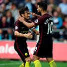 David Silva and Sergio Aguero celebrate a goal
