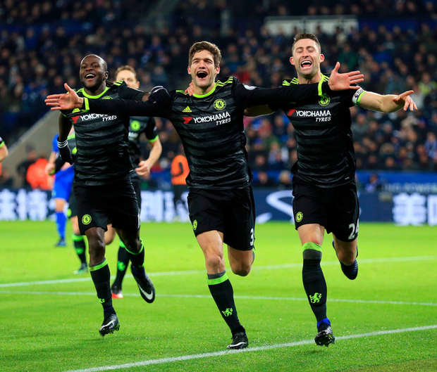 Chelsea's Marcos Alonso (centre) celebrates scoring his second goal against Leicester City with Victor Moses (left) and Gary Cahill. Photo: PA