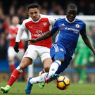 N'Golo Kante keeps possession ahead of Arsenal's Alexis Sanchez during Chelsea's victory last weekend. Photo: Getty Images
