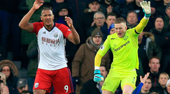 West Brom striker Salomon Rondon and Everton goalkeeper Jordan Pickford appeal to the referee to stop the game as James McCarthy lies on the ground with a broken leg Photo: PA