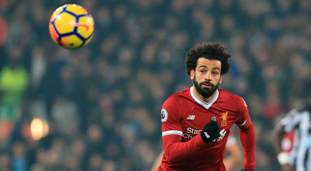 Mohamed Salah continued his remarkable scoring spree against Newcastle Photo: Getty
