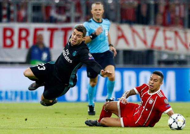 Real Madrid's Mateo Kovacic is fouled by Bayern Munich's Thiago Alcantara leading to a yellow card. Photo: Michaela Rehle/Reuters