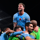 Kyle Walker celebrates with his team-mates after Ilkay Gundogan's goal sealed Manchester City's victory against Manchester United. Photo: Getty