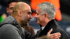 Guardiola and Jose Mourinho embrace after the match. Photo: AFP/Getty