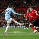 Silva service: Luke Shaw can't get close enough to Bernardo Silva to prevent Manchester City from taking the lead at Old Trafford last night. Photo: Action Images via Reuters