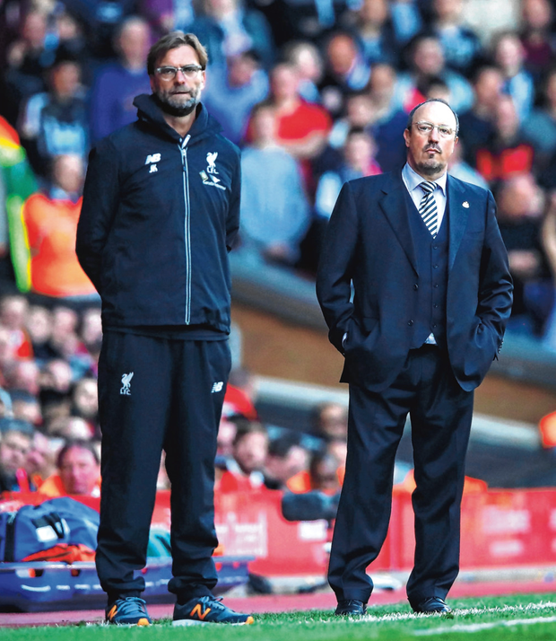 Jurgen Klopp knows his Liverpool team will have to battle hard to keep their Premier League ambitions alive against Rafa Benitez's Newcastle today. Photo: Getty