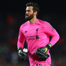 Alisson Becker (p) and his brother Muriel used to play football every day in a car park. Photo: Getty