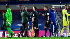 Manchester United manager Ole Gunnar Solskjaer talks to referee Stuart Attwell after the Premier League match at Stamford Bridge. Photo: Ian Walton/PA