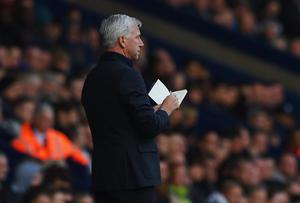 Alan Pardew manager of Newcastle United makes notes during the Barclays Premier League match between West Bromwich Albion and Newcastle United