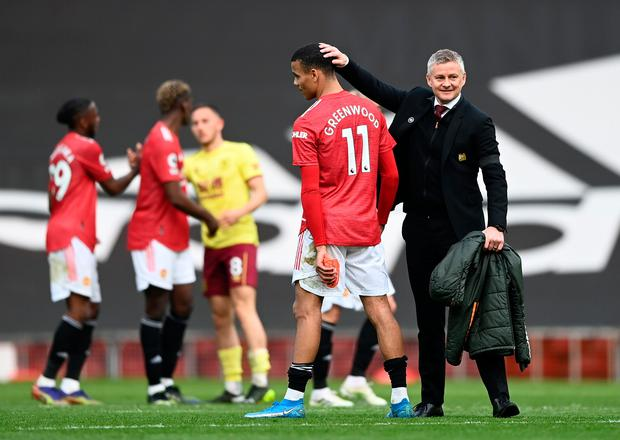 Manchester United's Mason Greenwood and Ole Gunnar Solskjaer celebrate following their Premier League victory over Burnley at Old Trafford. Photo: Gareth Copley/Getty Images