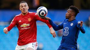 Chelsea's Callum Hudson-Odoi appears to handle the ball while in action with Manchester United's Mason Greenwood at Stamford Bridge. Photo: Ian Walton/Reuters
