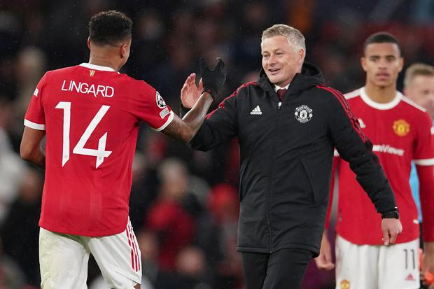Manchester United manager Ole Gunnar Solskjaer celebrates with Jesse Lingard following their Champions League Group F win over Villarreal at Old Trafford. Photo: Dave Thompson/AP