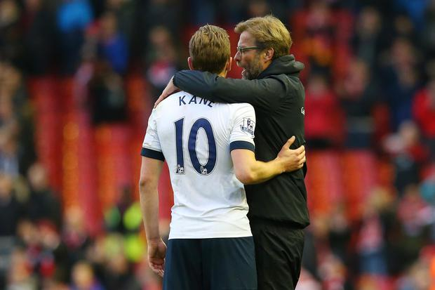 Jurgen Klopp, manager of Liverpool, talks to Harry Kane of Tottenham Hotspur after the Premier League match between Liverpool and Tottenham at Anfield on April 2, 2016. Photo: Alex Livesey/Getty Images