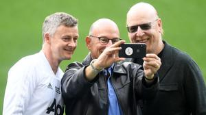 Manager Ole Gunnar Solskjaer poses for a picture with Avram Glazer (right), owner of Manchester United. Photo: Michael Regan