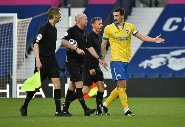 Brighton's Lewis Dunk speaks with referee Lee Mason after his side's game with WBA at The Hawthorns. Photo: Rui Vieira/Reuters