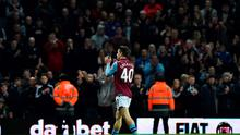 Aston Villa's English midfielder Jack Grealish leaves the pitch after receiving a red card