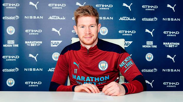 Manchester City's Kevin De Bruyne signing a two-year contract extension to 2025. Photo: Manchester City Football Club/PA