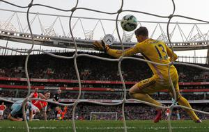 Arsenal midfielder Aaron Ramsey (4th L) scores his goal past West Ham United's goalkeeper Adrian