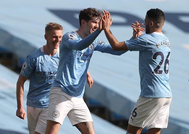 Manchester City's John Stones celebrates with Riyad Mahrez after scoring the winner in Saturday's victory over West Ham. Photo: Martin Rickett/Reuters
