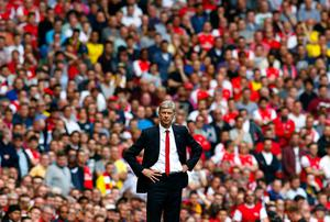 Arsenal's manager Arsene Wenger reacts during their English Premier League soccer match against Manchester City