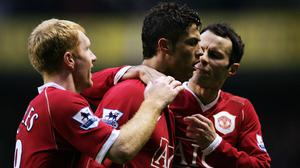 Cristiano Ronaldo (C) of Manchester United celebrates after scoring a penalty with team-mates Paul Scholes and Ryan Giggs during a game between Tottenham Hotspur and Manchester United at White Hart Lane on February 4, 2007. Credit: Getty Images