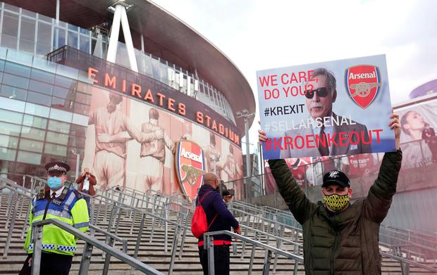 An Arsenal fan holds up a protest sign prior to his side's UEFA Europa League semi-final second leg against Villarreal at the Emirates Stadium, London. Photo: PA