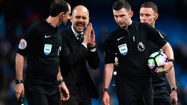 Pep Guardiola speaks to referee Michael Oliver after the Premier League match between Manchester City and Liverpool at Etihad Stadium.  (Photo by Michael Regan/Getty Images)