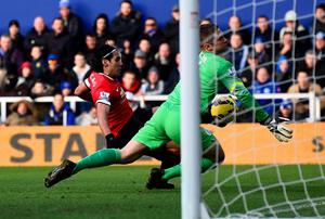 Radamel Falcao Garcia of Manchester United shoots towards Robert Green of QPR during the Barclays Premier League match between Queens Park Rangers and Manchester United