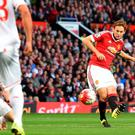 Daley Blind scores Manchester United's side's first goal in the win over Liverpool at Old Trafford last night