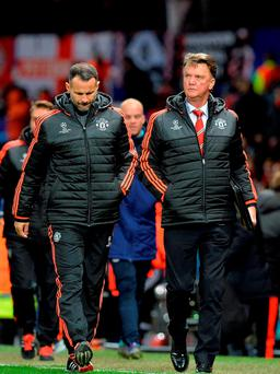 Manchester United manager Louis van Gaal and his assistant Ryan Giggs after their scoreless Champions League game against PSV