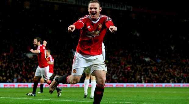 Wayne Rooney moved ahead of Denis Law on United's all-time scorer list with his first league goal since October Photo: PA