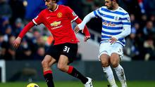 Marouane Fellaini of Manchester United shields the ball from Charlie Austin of QPR during the Barclays Premier League match between Queens Park Rangers and Manchester United