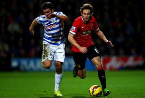 Daley Blind of Manchester United battles for the ball with Joey Barton of QPR during the Barclays Premier League match between Queens Park Rangers and Manchester United