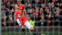 Wayne Rooney celebrates scoring against Tottenham Hotspur at Old Trafford