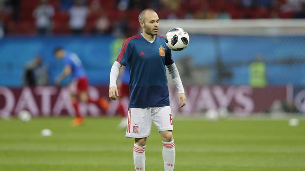 Andres Iniesta bows out of international football (Frank Augstein/AP)