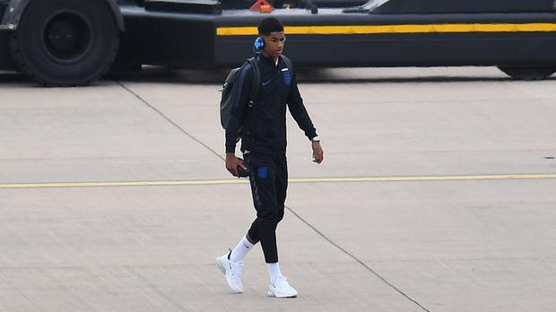 England's Marcus Rashford prepares to board the plane at Birmingham Airport, ahead of flying out to Russia for the 2018 FIFA World Cup.