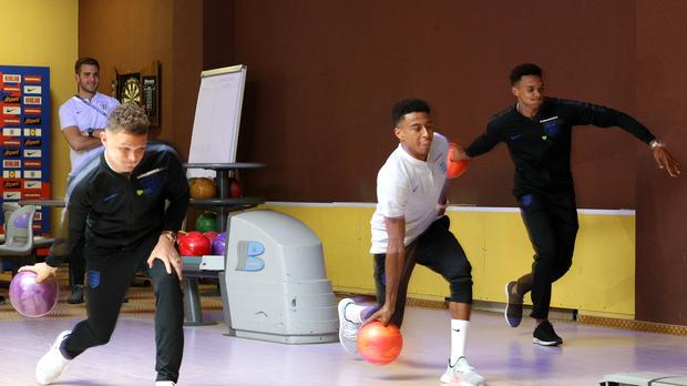 Kieran Trippier, left, Jesse Lingard, centre, and Trent Alexander-Arnold tried out tenpin bowling in Repino (Owen Humphreys/PA)