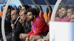 Mohamed Salah spent the whole of the game on the bench (Mark Baker/AP)