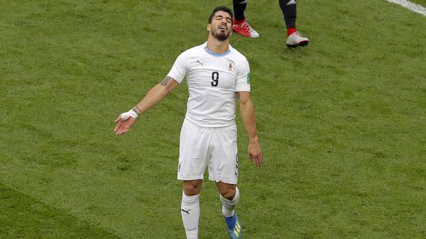 Uruguay's Luis Suarez had a frustrating time in the 1-0 win over Egypt (Vadim Ghirda/AP)