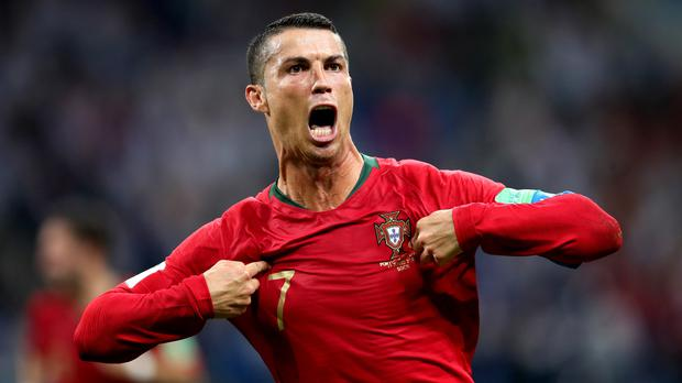 Cristiano Ronaldo celebrates scoring Portugal's third goal of the game and completing his hat-trick (Adam Davy/Empics)