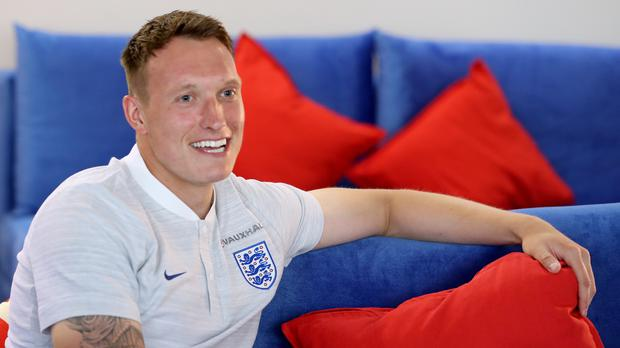 Phil Jones is happy with his Panini picture (Owen Humphreys/PA)